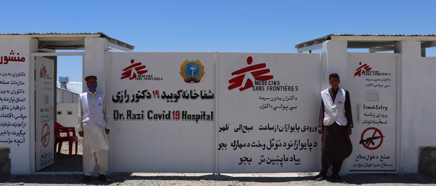 Staff members at the entrance to our new 32-bed COVID-19 treatment centre in Herat, where we focus on the treatment of patients with severe COVID-19 in need of oxygen therapy. Afghanistan, June, 2020